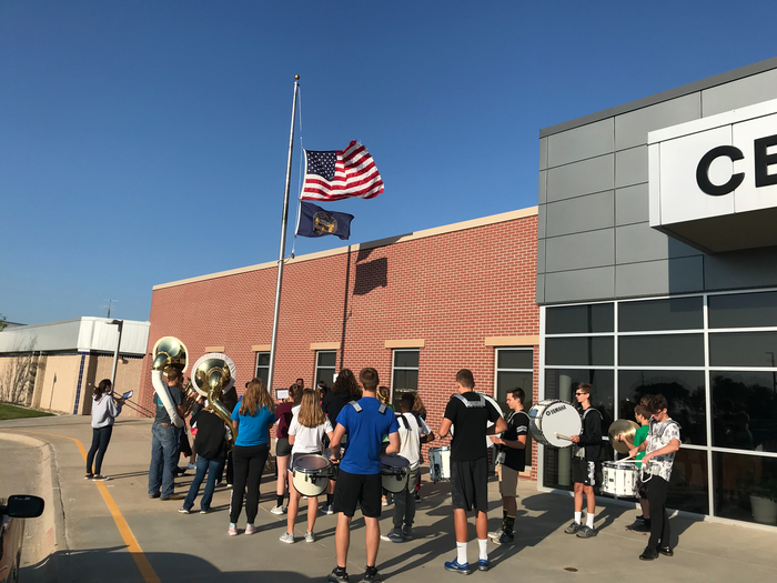 The Centennial band playing the National Anthem by the flag pole this morning in honor of Patriot Day. Great job!!